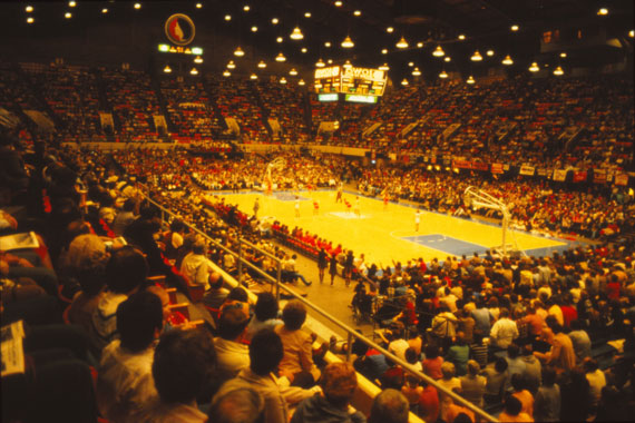 The girls state high school tournament regularly filled the largest auditorium in Iowa, Veterans Memorial in Des Moines. On the floor, the three offensive players wait at half-court for a rebound or a scored goal.